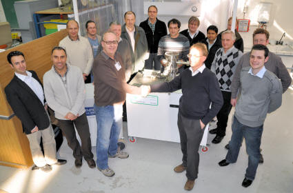 SS Scientific MD, Robin Hathaway, handing over an Outgassing Rig and Soft Clean Room (in background) to Robert Pearce, leader of the ITER Vacuum Group, watched by the rest of the team.